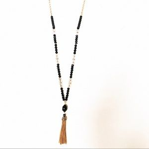 Beaded long black and gold necklace with tassel